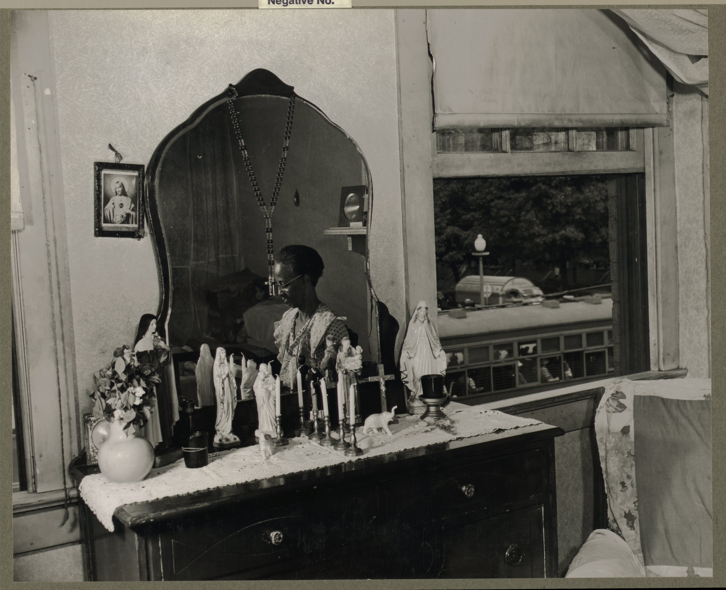 Fig. 17 Gordon Parks, photographer, Dresser in the bedroom of Mrs. Ella Watson, a government charwoman, August 1942