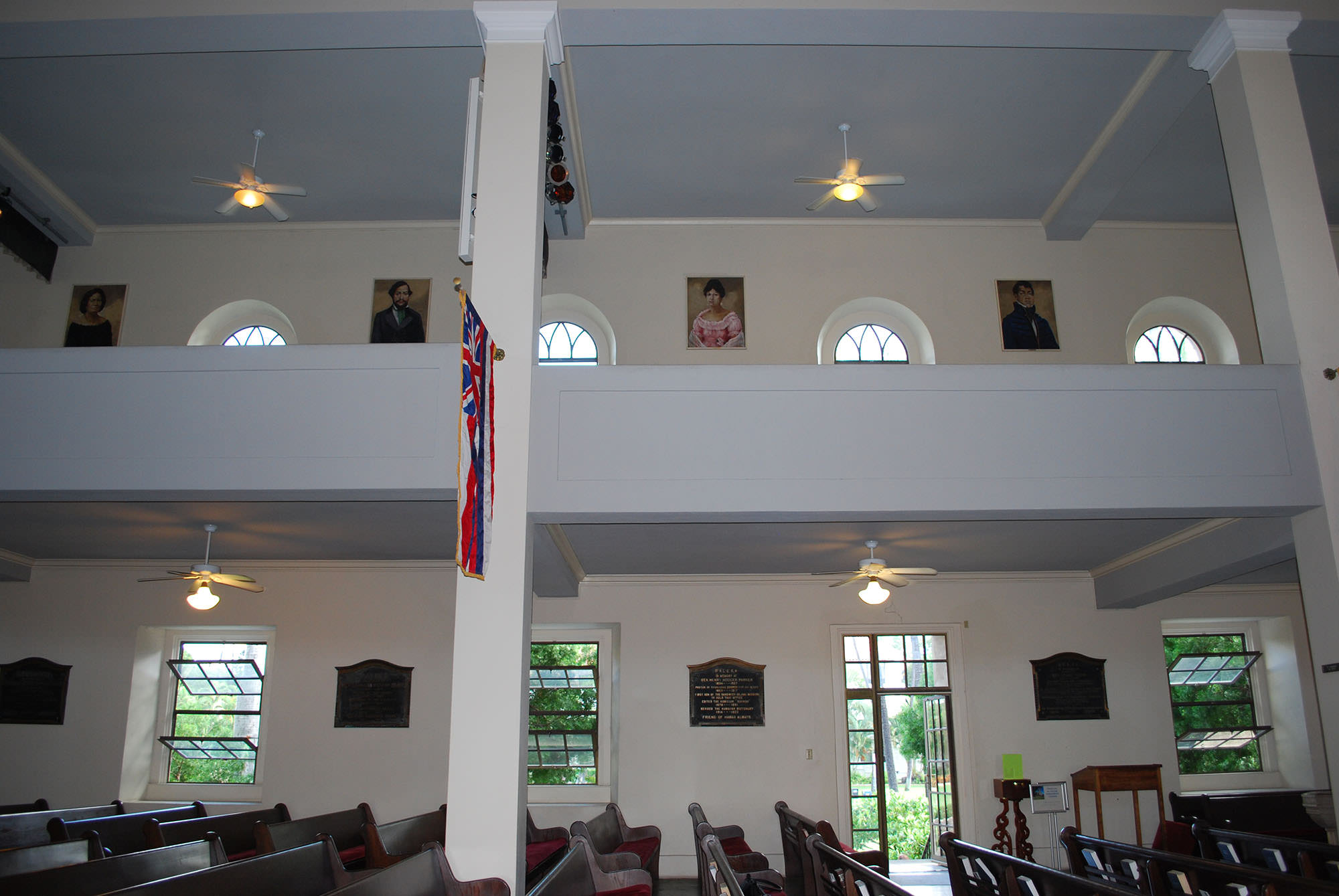 Fig. 11 Kawaiahaʻo Church, Oʻahu, interior, showing royal portraits and commemorative plaques in balcony and side aisles, February 2014. Photo: ©Sally Promey