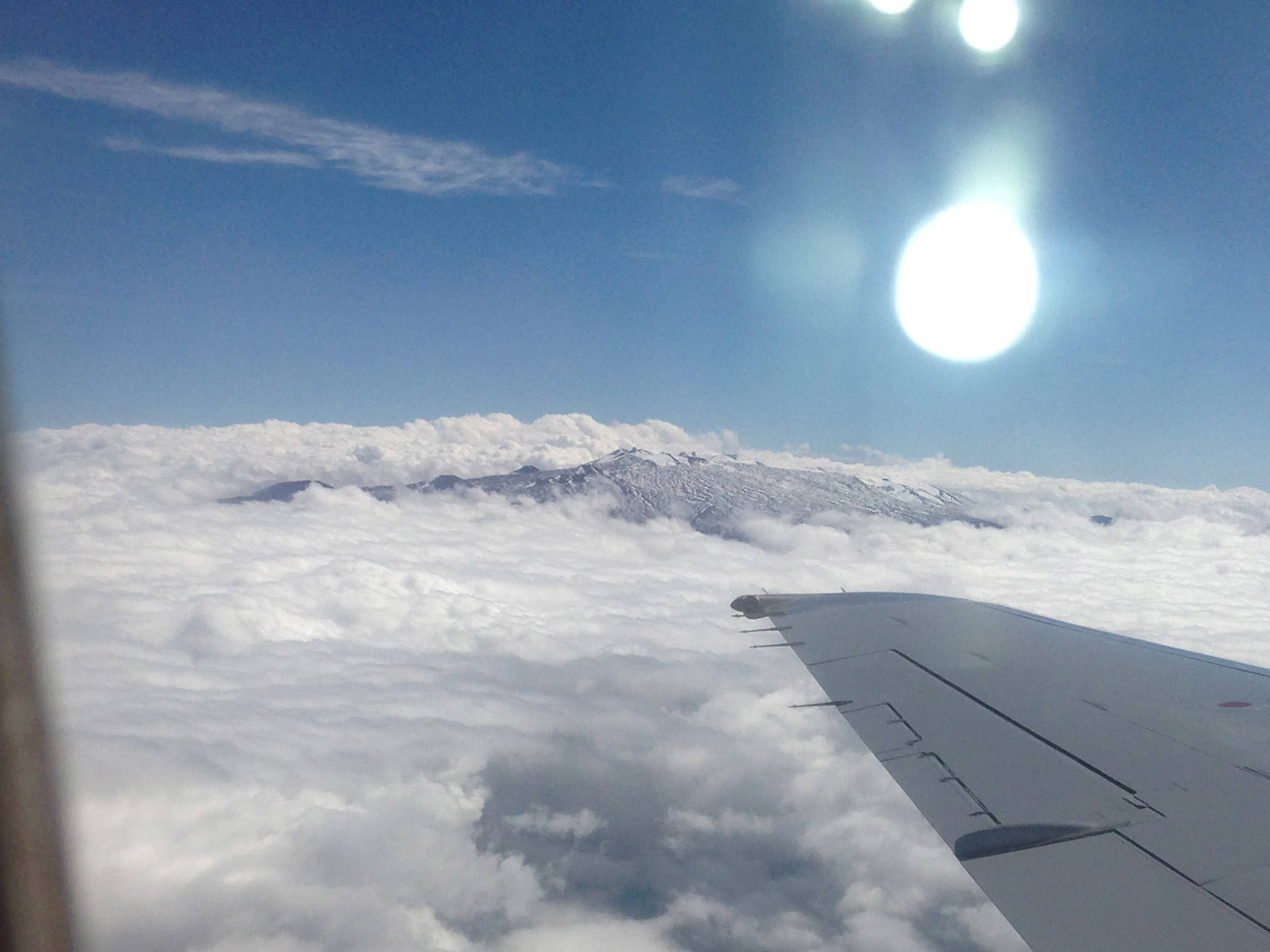 Fig. 17 Summit of Mauna Kea (Mauna a Wākea), Hawai'i Island, seen from airplane, March 2014. Photo: ©Sally Promey