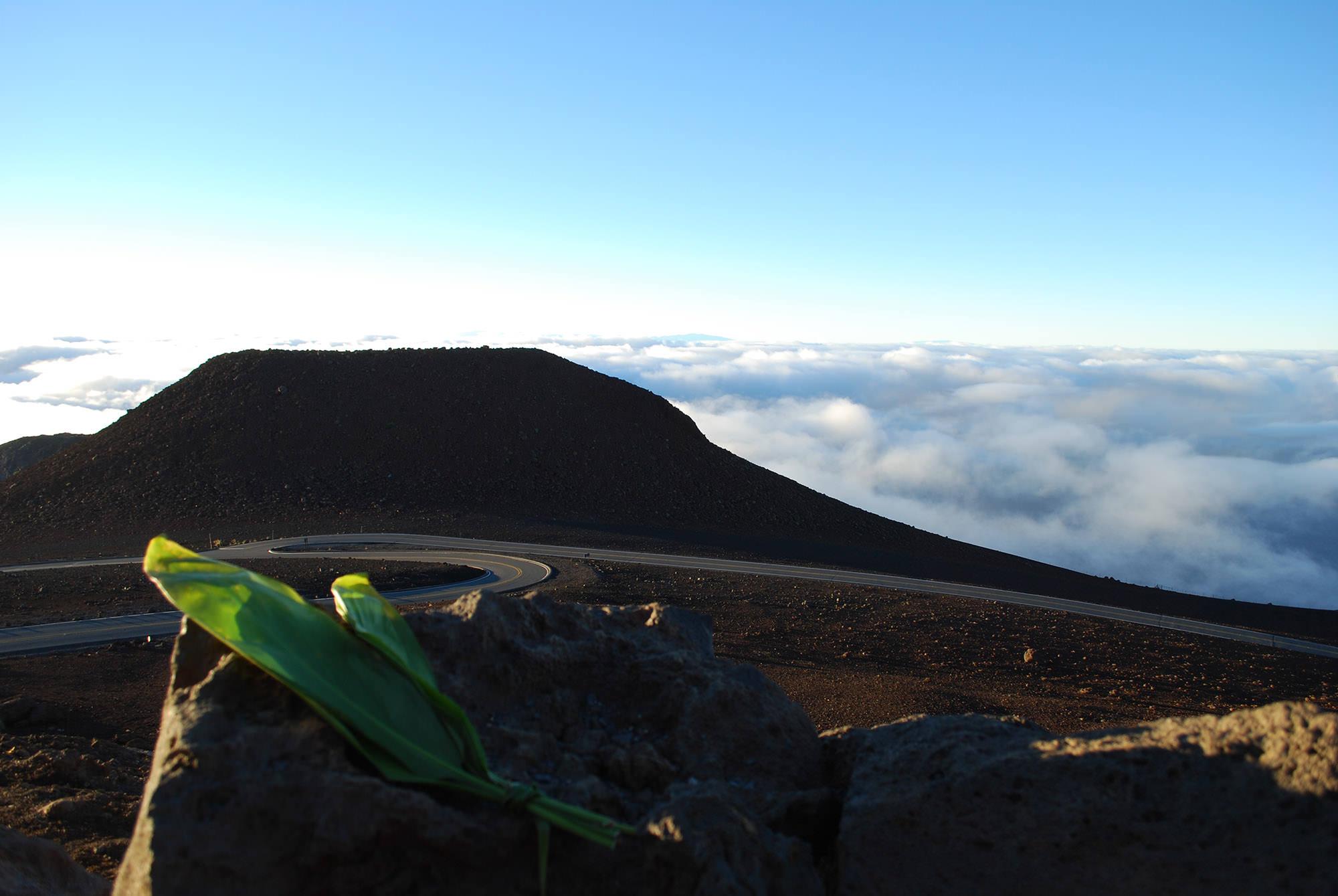Fig. 27 Offering on summit of Haleakalā, Maui, with summit of Mauna Kea (Mauna a Wākea) in distance, July 2015. Photo: ©Sally Promey