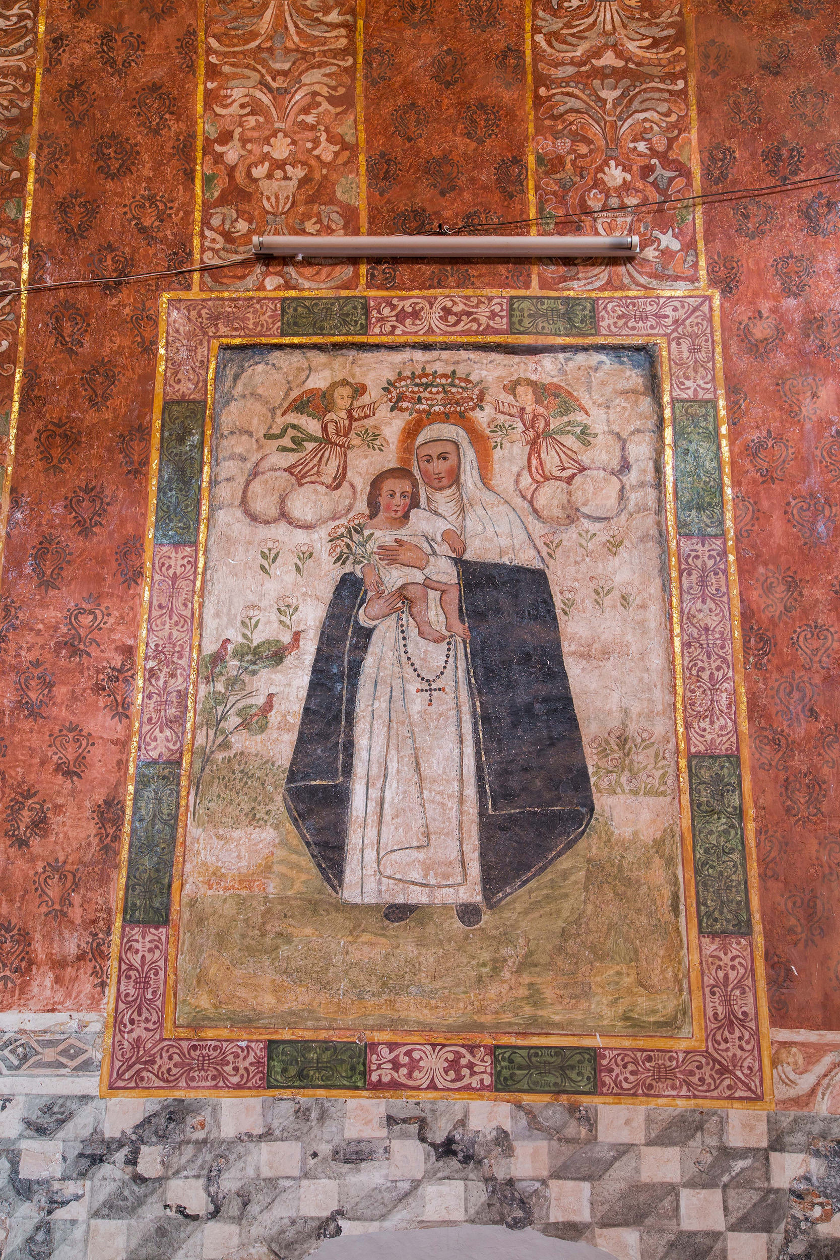 Fig. 24 Detail, textile mural of St. Rose of Lima surrounded by a cloth frame and set against damask hangings. Note the similarities in the frame design with the example from Oropesa. Church of Cai-Cai, Paucartambo Province, late 17th or early 18th century. Photo by Raúl Montero Quispe.