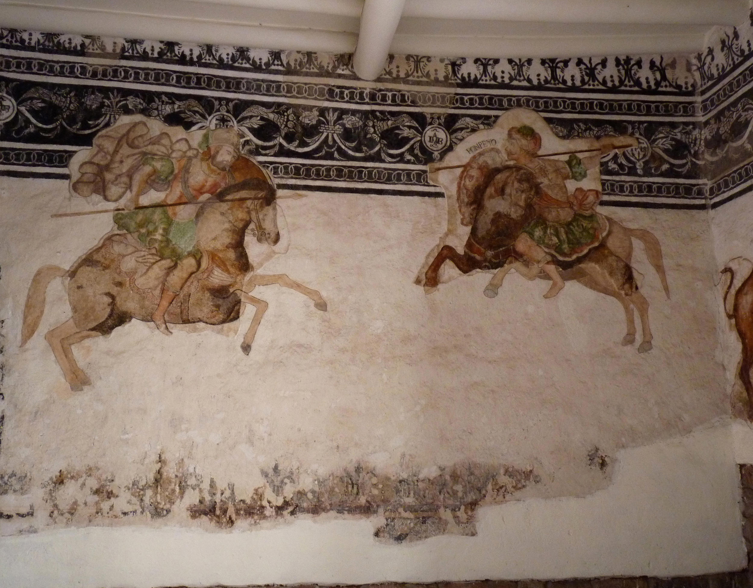 Fig. 3 Mural of what appears to be the Battle of Pharsalus, with Julius Caesar (left) defeating Pompey (right). Restorers have shown the black and white mural upon which this scene was painted. Casa de Antonio de Zea, Cuzco, 17th century. Photo by author.