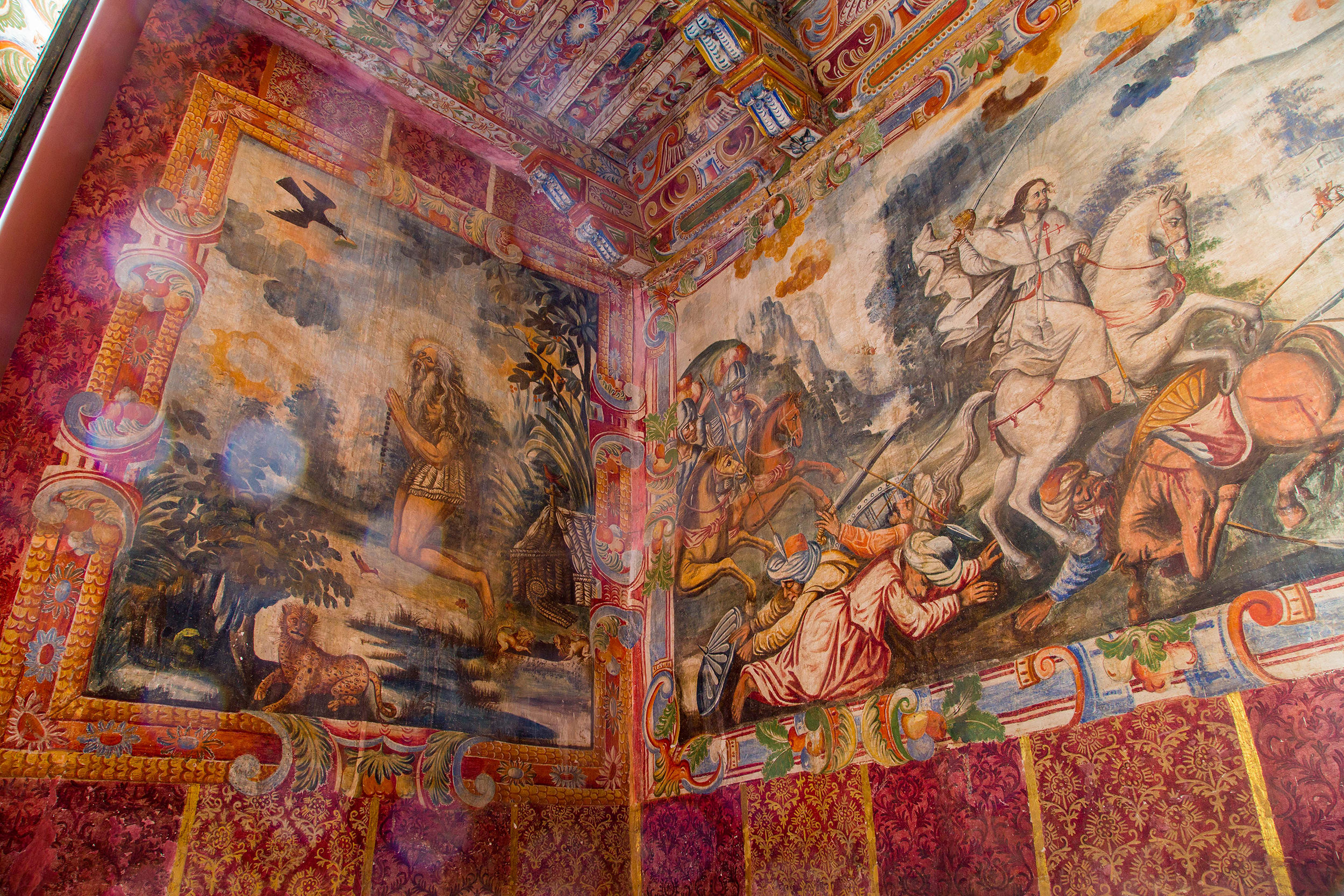 Fig. 43 Mural of St. Paul the Hermit and St. James at the Battle of Clavijo set against textile panels, 17th century. Church of Checacupe, Canchis Province. Photo by Raúl Montero Quispe.