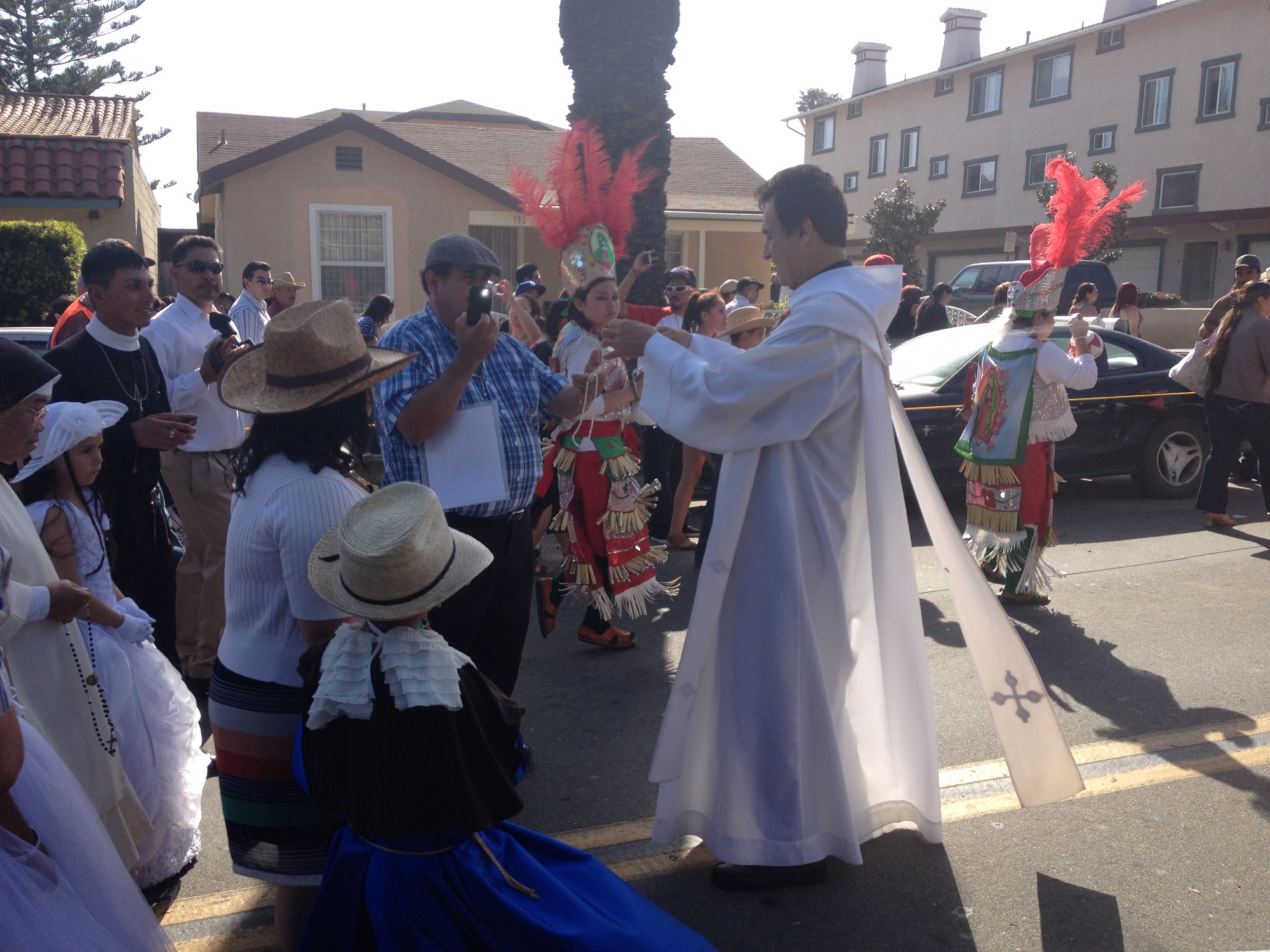 Padre Carlos blessing rosary beads at the procession of the Santo Niño de Atocha in Santa Paula, California.