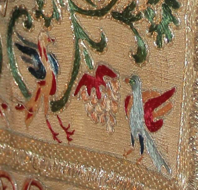 Detail of miter showing embroidered birds.