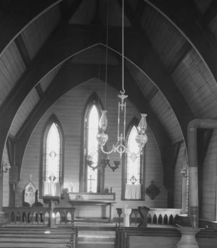 Interior nave and chancel of St. John in-the-Prairies Episcopal Church