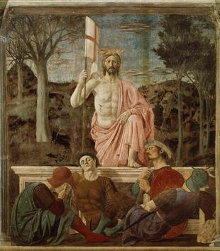 In a painting, a light skinned Christ rises up out of a marble tomb. He holds a white banner with a red cross and wears a pink cloth. Christ rests his foot on the lip of the tomb while other figures sleep leaning against it.