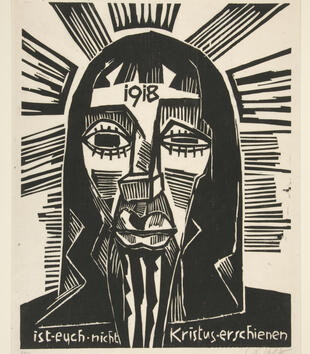 """A woodblock print depicts Christ's face in a flat angular style. He has geometric eyes with an angular nose, large lips, and a dark beard. """"1918"""" is inscribed on his forehead and """"ist euch nicht Kristus-erschienen."""""""