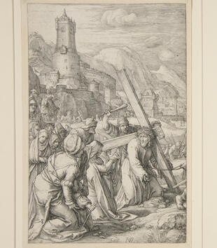 In the foreground of an engraving, Christ carries the cross. He has fallen to his knees and the crowd gathers around him with weapons. A palace and a mountain range stand in the background.