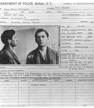 A rectangular card from the Buffalo Police Department includes frontal and profile portraits of a light-skinned man. A typed data form accompanies the black and white photos. It includes his name, body measurements, occupation, scars, and crimes.