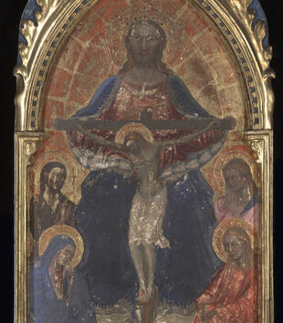 A tempera panel painting depicts the crucified Christ held between the open arms of a larger scale enthroned Christ. A dove floats above the cross. The Virgin and other saints gather at the foot of the cross. The image's gold leaf and paint is weathered.