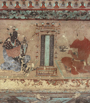 In a mural on a cave wall, robed figures gather around a painted tablet. Two larger figures kneel while their attendants hold offerrings. Much of the colorful paint has chipped off the figures.