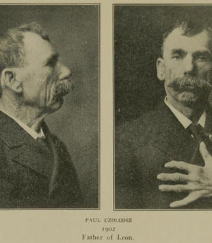 Profile and frontal views of an older, mustached light-skinned man are side-by-side in a sepia document. In the frontal view, the man places his left hand over his chest. He wears a button on his jacket.