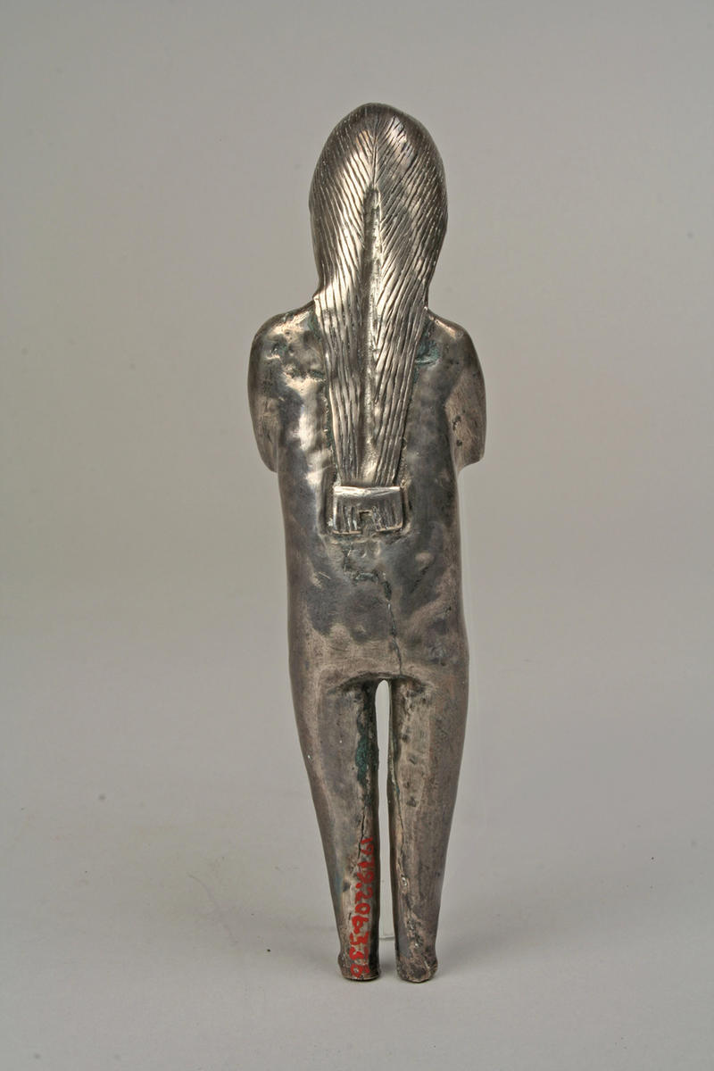 Fig. 11 Inca Standing Silver Female Figurine (back), 15th–16th century, Metropolitan Museum of Art 1979.206.336