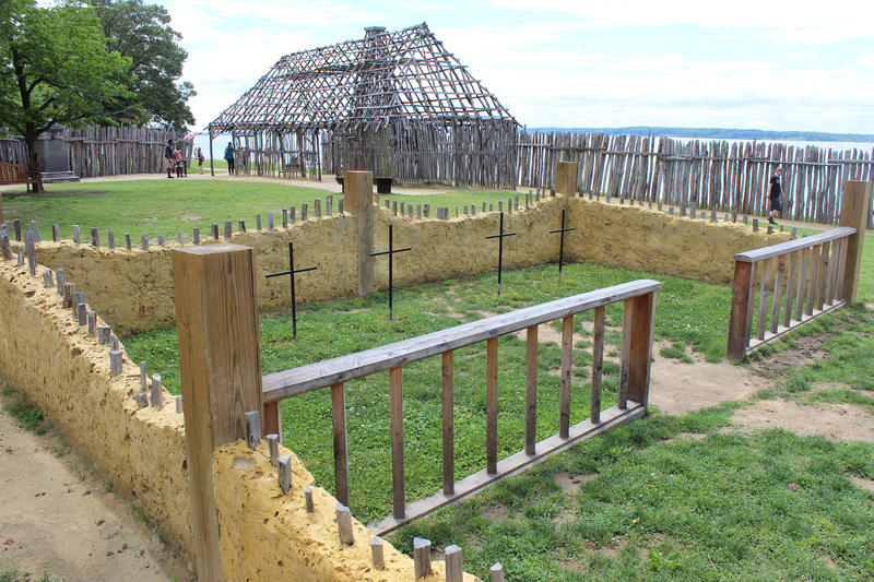 Fig. 5 View into the chancel of the partial reconstruction of the chapel on the original site at Jamestown. Archer was buried below the third cross from the left. The placement of the crosses, walls and communion rail are modern, based on archaeological evidence. Photo by author.