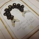 """A gold border encircles a braided piece of hair arranged in an arc on a book page. Bows are tied on the hair tips. Handwritten script below reads, """"Mother. Died Dec. 16th 1867. Aged 56 years."""""""